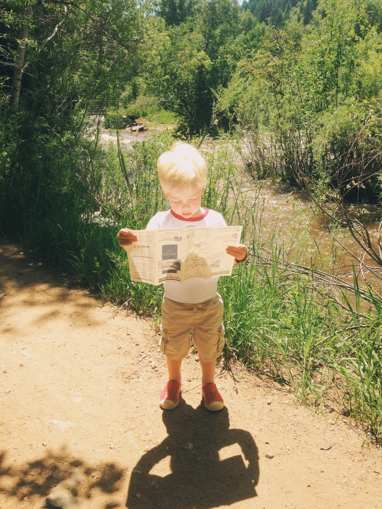 Finn consulting his trail map while on a hike.